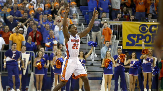Florida guard Michael Frazier II (20) celebrates after their 57-56 win over Arkansas in an NCAA college basketball game at the Stephen C. O'Connell Center, Saturday, Jan. 31, 2015, in Gainesville, Fla. (AP Photo/The Gainesville Sun, Matt Stamey)  THE INDEPENDENT FLORIDA ALLIGATOR OUT
