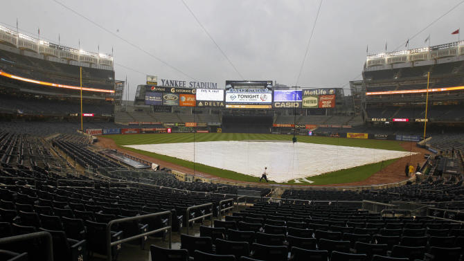 The field is covered at Yankee Stadium for the game between the New York Yankees and the Tampa Bay Rays, Friday, July 8, 2011, at Yankee Stadium in New York. The game was called due to rain. (AP Photo/Frank Franklin II)