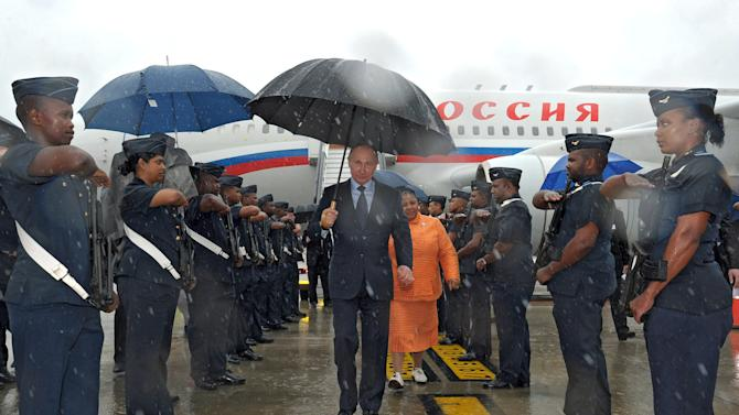 Russian President Vladimir Putin walks during a welcome ceremony on his arrival in Durban, South Africa, Tuesday, March 26, 2013. Vladimir Putin is on a working visit and set to meet with South African officials on Tuesday before attending a meeting with the leaders of Brazil, Russia, India and China (BRICS) during an Africa Dialogue Forum in Durban on Wednesday. (AP Photo/RIA-Novosti, Alexei Druzhinin, Presidential Press Service,Pool)