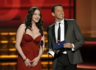 Kat Dennings, left, and Jon Cryer present an award onstage at the 64th Primetime Emmy Awards at the Nokia Theatre on Sunday, Sept. 23, 2012, in Los Angeles. (Photo by John Shearer/Invision/AP)