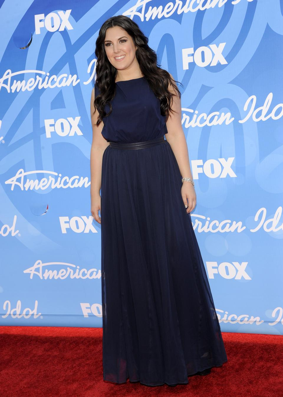 "Kree Harrison arrives at the ""American Idol"" finale at the Nokia Theatre at L.A. Live on Thursday, May 16, 2013, in Los Angeles. (Photo by Chris Pizzello/Invision/AP)"