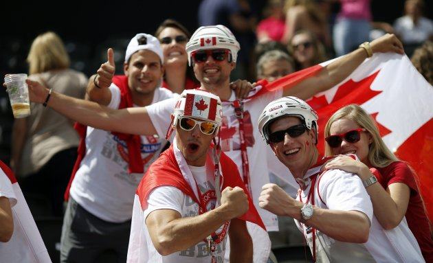 Fans of Canada pose during the men's preliminary round beach volleyball match between Canada and Norway at the London 2012 Olympic Games at Horse Guards Parade