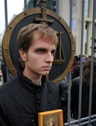 "A Russian holds a religious icon during an anti-Pussy Riot protest outside a Moscow courthouse on October 10. A member of the anti-Kremlin punk band who freed unexpectedly from prison said there is no split within the group, accusing the authorities of playing a ""strange game"" against the women"
