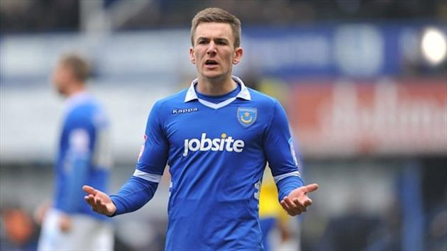 Jed Wallace opened the scoring as Portsmouth won their first game of the season