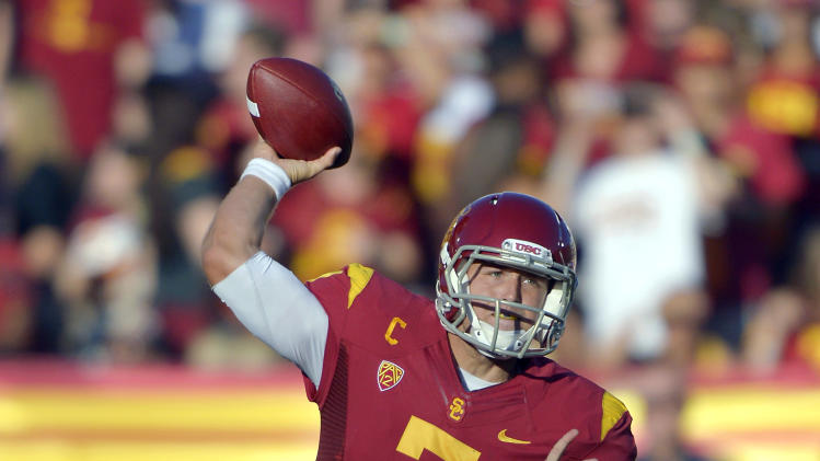 Southern California quarterback Matt Barkley passes during the first half of their NCAA college football game against Hawaii, Saturday, Sept. 1, 2012, in Los Angeles. (AP Photo/Mark J. Terrill)