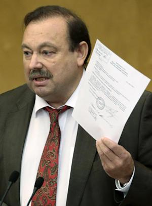 Russian opposition lawmaker Gennady Gudkov holds a document as he speaks during a plenary session of the State Duma, the lower parliament chamber, in Moscow, Russia, Friday, Sept. 14, 2012. Russia's lower house of parliament is voting Friday Sept. 14, 2012 to expel Gudkov, who has angered the Kremlin with his scathing criticism and participation in opposition rallies. (AP Photo/Mikhail Metzel)
