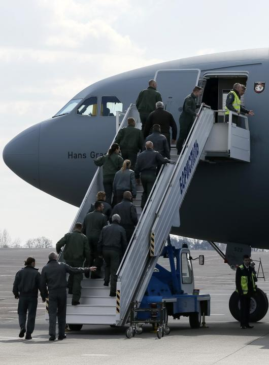 German soldiers board a medical military aircraft in Boryspil airport