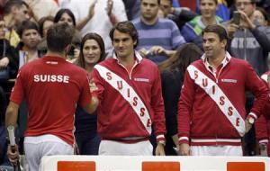 Switzerland's Federer and Lammer congratulate Wawrinka after winning his Davis Cup world group first round tennis match against Serbia's Lajovic in Novi Sad
