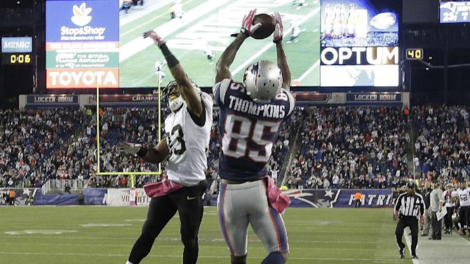 New England Patriots wide receiver Kenbrell Thompkins (85) catches the winning touchdown pass against New Orleans Saints cornerback Jabari Greer (33) in the fourth quarter of an NFL football game Sunday, Oct.13, 2013, in Foxborough, Mass. The Patriots won 30-27. (AP Photo/Stephan Savoia)