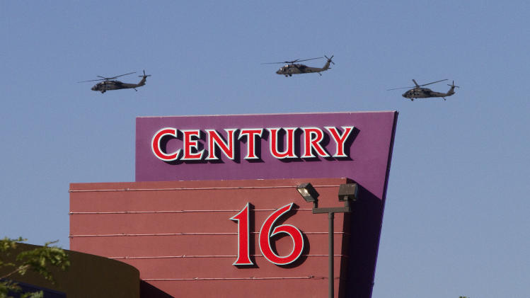 Three helicopters make a flyover of the Century Theater on Saturday, July 21, 2012 in Aurora, Colo. Twelve people were killed and dozenswere injured in the attack early Friday at the packed theater during a showing of the Batman movie,