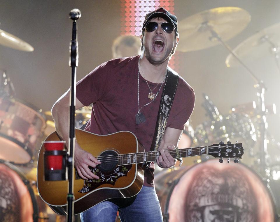 Eric Church performs on an outdoor stage during the CMT Music Awards show on Wednesday, June 6, 2012, in Nashville, Tenn. (AP Photo/Mark Humphrey)