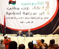 "Mohammed Sawan (R) announces the establishment of the new Justice and Construction party in Libya, in the capital Tripoli in March. ""Women gave a lot of hard work to support the revolution, so why not enter the government now?"" asked Samira Karmusi, who is running with the Justice and Construction Party"