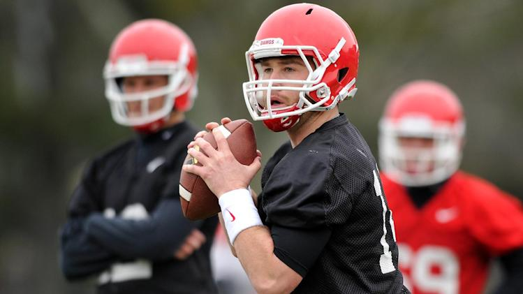In a March 18, 2014, file photo Georgia quarterback Hutson Mason  drops back to pass during a Georgia spring football practice in Athens, Ga.  Mason, a fifth-year senior, will startt when No. 12 Georgia opens the season next week with a crucial game against No. 16 Clemson