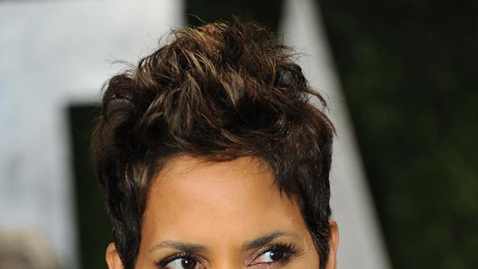 """FILE - This Feb. 24, 2013 file photo shows actress Halle Berry at the 2013 Vanity Fair Oscar party at the Sunset Plaza Hotel in West Hollywood, Calif. The Oscar-winning actress had hoped to move to France with 4-year-old Nahla and Berry's fiance, Oliver Martinez. But a judge in her custody dispute with Nahla's father, Gabriel Aubry, prevented that last year. Berry says she's now trying to figure out how to make life """"more normal"""" for Nahla in the Los Angeles area, where they live.  (Photo by Jordan Strauss/Invision/AP, file)"""