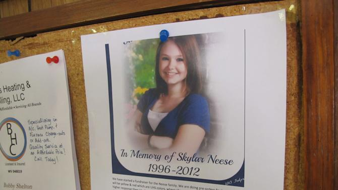 FILE - In this Thursday May, 23, 2013 file photo shows a flyer at John's Barber Shop in Star City, W.Va.,talk every day about the unanswered questions surrounding the murder of 16-year-old honors student Skylar Neese, whose face still smiles out from a bulletin board flier. (AP Photo/Vicki Smith)
