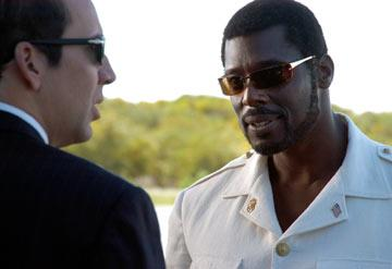 Nicolas Cage and Eamonn Walker in Lions Gate Films' Lord of War