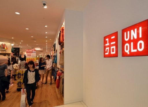 <p>Customers browse at a megastore of Japanese fashion giant Uniqlo in Tokyo on October 6, 2012. The operator of Japan's cheap-chic clothing giant Uniqlo looks set to push its revenue past the 1 trillion yen ($12.8 billion) threshold next year, the company said Thursday.</p>