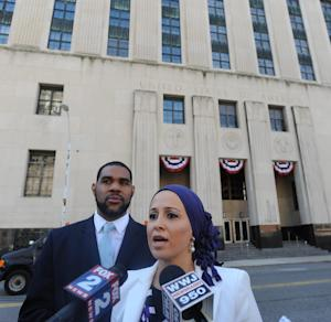 Dawud Walid, left, executive director of the Michigan chapter of the Council on American-Islamic Relations, and staff attorney Lena Masri speak about a lawsuit in front of the federal courthouse in Detroit on Thursday, Aug. 14, 2014. The civil rights group filed a federal lawsuit Thursday challenging the placement of five Detroit-area Muslims on a national watch list of suspected terrorists and their associates. (AP Photo/The Detroit News, Brandy Baker)