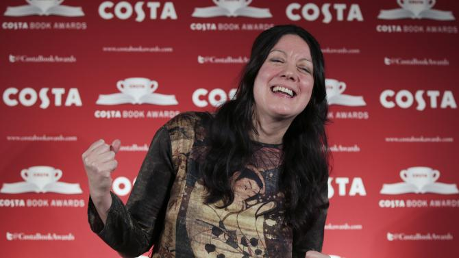 Author Helen MacDonald, winner of the 2014 Costa Book of the Year Award poses at ceremony in London