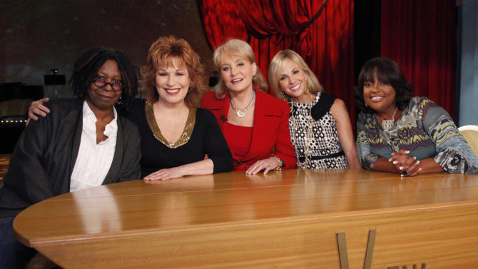 "FILE - In this file TV publicity image released by ABC, from left, Whoopi Goldberg, Joy Behar, Barbara Walters, Elizabeth Hasselbeck and Sherri Shepherd pose on the set of their daytime talk show, ""The View."" Hasselbeck is leaving the desk at ""The View"" for the couch on Fox News Channel's ""Fox & Friends."" The news network said Tuesday, July 9, 2013, that Hasselbeck, who has been on Barbara Walters' syndicated daytime show for a decade, will join co-anchors Steve Doocy and Brian Kilmeade on Fox's morning show in September. (AP Photo/ABC, Heidi Gutman, File)"