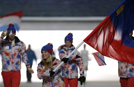 Liechtenstein's flag-bearer Weirather leads her country's contingent during the athletes' parade at the opening ceremony of the 2014 Sochi Winter Olympics