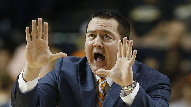 "FILE - In this March 12, 2015, file photo, Tennessee head coach Donnie Tyndall speaks to players during the first half of an NCAA college basketball game in the second round of the Southeastern Conference tournament against Vanderbilt in Nashville, Tenn. Tennessee has fired basketball coach Donnie Tyndall after one season. Tyndall's firing comes as the NCAA investigates his two-year stay at Southern Mississippi, where he coached before coming to Tennessee last year. Tennessee athletic director Dave Hart said in a statement Friday, March 27, 2015, it is ""highly likely"" Tyndall will face ""significant penalties"" after the NCAA completes its inquiry.(AP Photo/Steve Helber, File)"