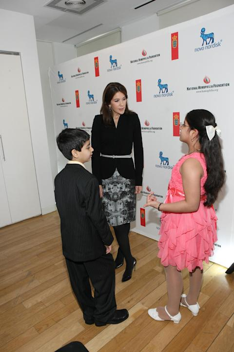 (L - R) Her Royal Highness (HRH) Crown Princess Mary of Denmark (C), Porus Pavri, and Farah Pavri are seen at a Novo Nordisk/National Hemophilia Foundation (NHF) event, Bryant Park Hotel, on March 11,