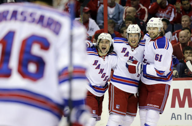 New York Rangers right wing Mats Zuccarello (36), from Norway, defenseman Michael Del Zotto (4), and left wing Rick Nash (61) celebrate Del Zotto's goal in the second period, of Game 7 first-round