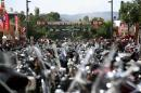 FILE - This Aug. 1, 2014 file photo shows the streets of Sturgis, S.D., lined with motorcycles days before the official kickoff of the 74th annual Sturgis Motorcycle Rally. Members of a Black Hills family and their friends say they mean no harm with a betting pool they run on how many bikers will die during the annual rally. This year, 12 people put in $5 each, with the winner pocketing $60. The state Highway Patrol said four fatalities were recorded at this year's rally, which ended last weekend, down from six last year. (AP Photo/Toby Brusseau, File)