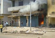 Fire breaks out in a store during clashes between rival gangs in Marche Madina, in Conakry March 1, 2013. REUTERS/Saliou Samb
