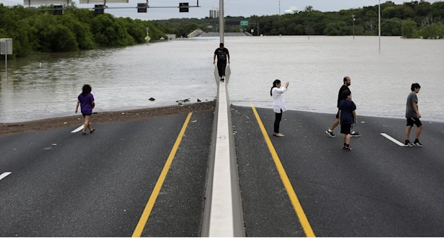 Flood waters cover eight lanes of Highway 281, Saturday, May 25, 2013, in San Antonio.  The San Antonio International Airport by Saturday afternoon had recorded nearly 10 inches of rain since midnight