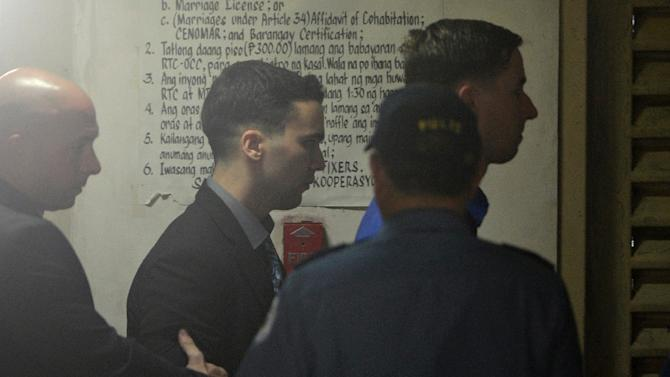 US Marine Joseph Scott Pemberton (centre) is led into court during his murder trial in Olongapo City, on December 1, 2015