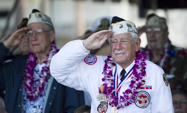 Pearl Harbor survivors stand at attention during the National Anthem during the Pearl Harbor memorial ceremony, Wednesday, Dec. 7, 2011, in Pearl Harbor, Hawaii. Today marks the 70th anniversary of the surprise attack on Pearl Harbor Naval Base which pulled the US into a war with Japan. (AP Photo/Marco Garcia)