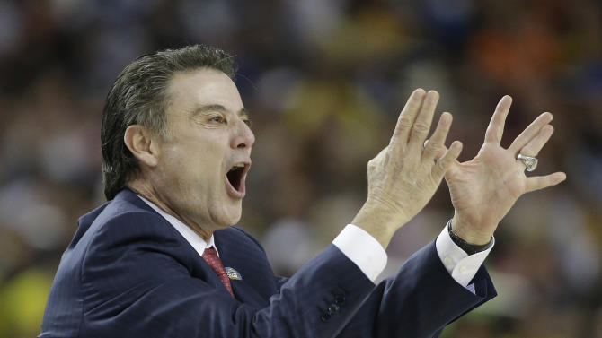 Louisville head coach Rick Pitino watches play against Wichita State during the first half of the NCAA Final Four tournament college basketball semifinal game Saturday, April 6, 2013, in Atlanta. (AP Photo/David J. Phillip)