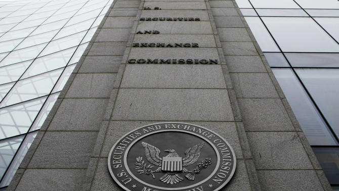 FILE- In this Dec. 17, 2008 file photo, the Securities and Exchange Commission (SEC) headquarters in Washington is shown. Regulators are expected to vote Wednesday July 23, 2014 to end a longtime staple of the investment industry _ the fixed $1 share price for money-market mutual funds _ at least for some money funds used by big investors. (AP Photo/File)