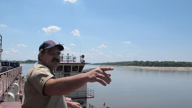 Frank Segree, captain of the U.S. Army Corps of Engineers' Dredge Hurley, points as he talks to reporters about dredging operations on the Mississippi River on Monday, Aug. 20, 2012 near Memphis, Tenn. The Mississippi River from Illinois to Louisiana has seen water levels plummet due to drought conditions in the past three months. Near Memphis, the river level was more than 12 feet lower than normal for this time of year. (AP Photo/Adrian Sainz)