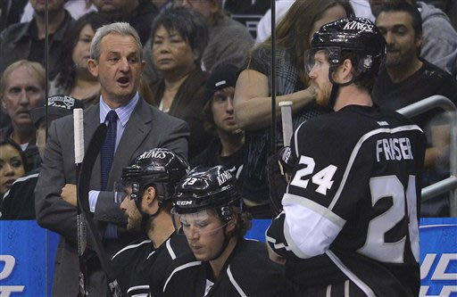 Los Angeles Kings coach Darryl Sutter, left, comments to center Colin Fraser (24) in the first period during Game 5 of the Western Conference semifinals in the NHL hockey Stanley Cup playoffs, Thursda