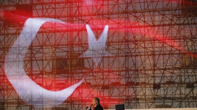 Turkey's President Recep Tayyip Erdogan delivers a speech during a rally to commemorate the anniversary of the city's conquest by the Ottoman Turks, Istanbul, Turkey, Saturday, May 30, 2015. The Justice and Development Party (AKP), which has been ruling Turkey since 2002, is running in the upcoming general elections which are to be held on June 7, 2015, where approximately 56 million Turkish voters are eligible to cast their ballots to elect the 550 members of the Grand National Assembly. (AP Photo/Lefteris Pitarakis)