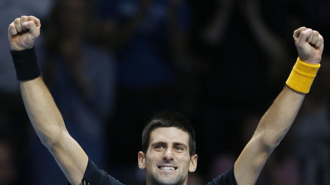Novak Djokovic of Serbia celebrates beating Tomas Berdych of the Czech Republic during their singles tennis match at the ATP World Tour Finals in London Friday, Nov. 9, 2012. (AP Photo/Kirsty Wigglesworth)