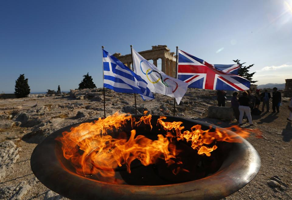 The cauldron with the Olympic Flame is seen atop the Athens Acropolis Wednesday May 16, 2012 during a ceremony. The Olympic flame will be handed over to the London 2012 delegation on Thursday.  (AP Photo/Yannis Behrakis/pool)