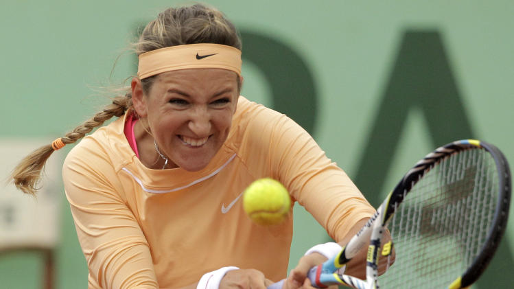 Belarus' Victoria Azarenka returns the ball to Slovakia's Dominika Cibulkova during their fourth round match in the French Open tennis tournament at the Roland Garros stadium in Paris, Sunday, June 3, 2012.  (AP Photo/Michel Spingler)