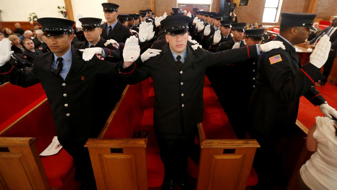 Firefighter cadets are sworn into the Newark Fire Department during a ceremony at New Hope Baptist Church, Tuesday, Oct. 9, 2012, in Newark, N.J. Twenty-eight of the 31 cadets served in the U.S. military fighting in Afghanistan or Iraq. The veterans were recruited through the GI Go Fund, a nonprofit New Jersey-based organization that helps provide assistance for veterans. The group worked with Mayor Cory Booker to open a Veterans Center in Newark City Hall. (AP Photo/Julio Cortez)