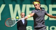 Roger Federer, seen here on June 17, insists he can still match Pete Sampras's record of seven Wimbledon triumphs despite Novak Djokovic and Rafael Nadal having developed an iron grip on Grand Slam glory