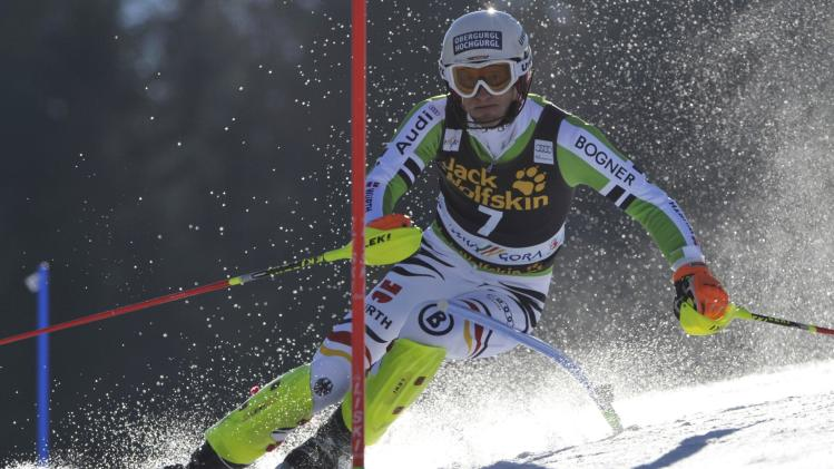 Dopfer of Germany clears a gate during the first run of the Alpine Skiing World Cup men's slalom ski race in Kranjska Gora