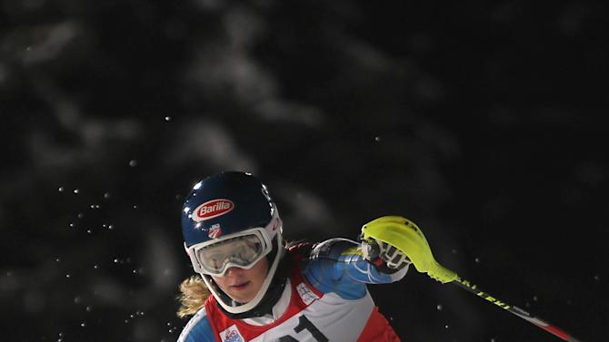 Mikaela Shiffrin, of the United States, speeds past a pole on her way to clock the second fastest time in the first run of an alpine ski, women's World Cup slalom, in Flachau, Austria, Tuesday, Jan. 15, 2013. (AP Photo/Marco Trovati)