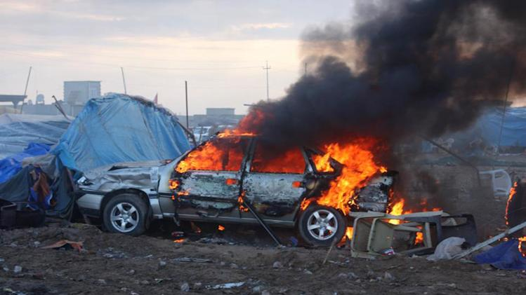 This image released by Human Rights Watch on Saturday, May 4, 2013 shows a vehicle burning after a raid by Iraqi security forces on a Sunni protest camp in a public square that killed scores in Hawija, Iraq on April 23. Human Rights Watch on Saturday urged Iraqi authorities to give a government committee charged with probing a deadly raid by security forces on a protest camp last week greater financial and political backing to investigate who is responsible for what it described as an apparently unlawful use of lethal force.(AP Photo/Human Rights Watch)