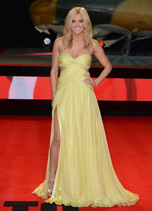 Dancing on Ice judge Ashley Roberts wore this pretty yellow dress with a thigh high split to a film premiere. Copyright [Splash]