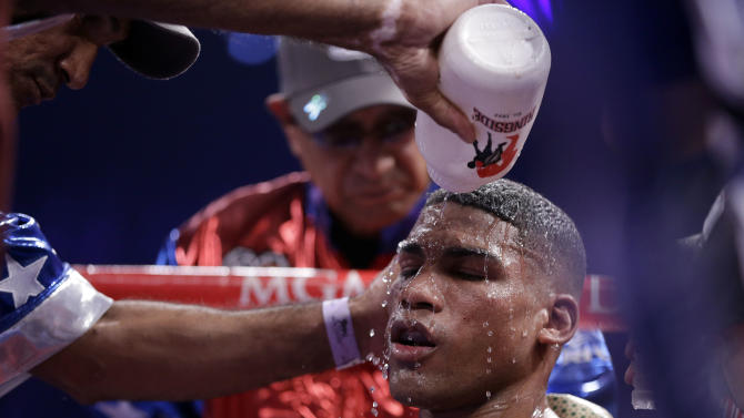 Yuriorkis Gamboa, from Miami, Fla., is cooled down in his corner during his WBA interim super featherweight title fight against Michael Farenas, from the Philippines, Saturday, Dec. 8, 2012, in Las Vegas. (AP Photo/Julie Jacobson)
