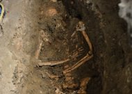 A view of the third excavation of a grave inside the medieval Convent of Saint Ursula in Florence on July 17. Archaeologists on Tuesday unearthed a skeleton in a rare state of preservation in Florence in a crucial step towards unravelling the mystery of the identity of the woman with the most enigmatic smile in the world - the Mona Lisa