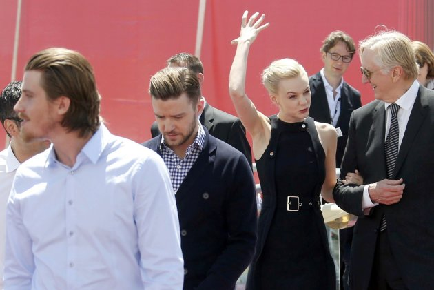 Cast members Garrett Hedlund, Justin Timberlake, Carey Mulligan leave after a photocall for the film 'Inside Llewyn Davis' at the 66th Cannes Film Festival